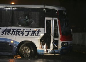 Manila bus hijack: A body hangs from the glass door of the tourist bus