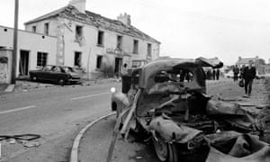 A car lies wrecked after the Claudy attack in 1972
