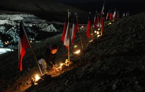 Chilean Miners Update: Andrea Aravena, relative of the trapped miners, lights candles