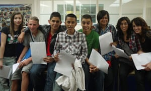 Students at Paddington Academy in London celebrate their GCSE results on 24 August 2010.