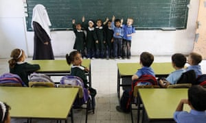 Palestinian elementary students attend a