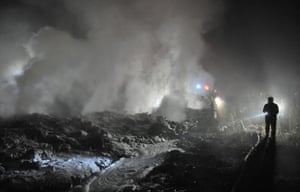 24 hours in pictures: Rescuers check the wreckage of a crashed passenger plane in Yichun