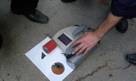 Police in Moldova take Geiger counter readings of materials found in a garage in Chisinau