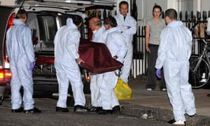 The corpse of MI6 agent Gareth Williams is removed by crime officers yesterday