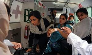 Afghan schoolgirls after suspected poison attack