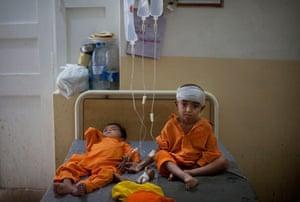 pakistan aftermath: Pakistani boys are treated at the pediatric ward of the hospital in Sukkar