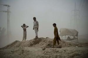 pakistan aftermath: Locals await relief goods after flooding in Muzaffargarh