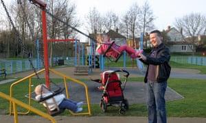 father children swings park