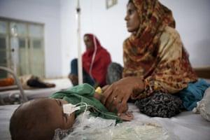 Pakistan Pregnant Women: Muhammad, three-months-old boy is given intravenous antibiotics on a ward