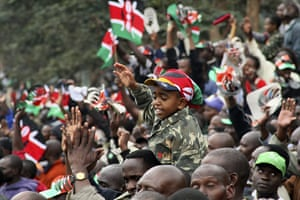 Kenya Constitution: A young boy reacts as Kenyans watch the signing of the new constitution