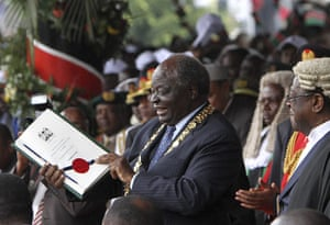 Kenya Constitution: President Mwai Kibaki displays the Oath of Due Execution of office