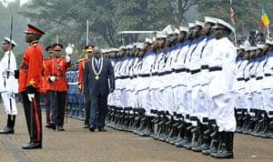 Kenya Constitution: Kenya's President Mwai Kibalki (C) reviews the guard of honour