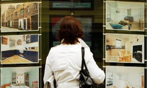 Homes for sale in window of estate agent