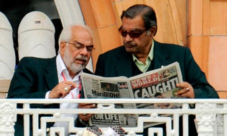 Pakistan's manager Yawar Saeed reading the News of the World
