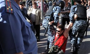 Russian police detain a demonstrator