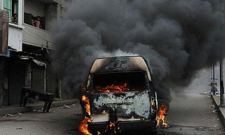 A van burns in Karachi