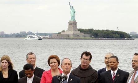 Michael Bloomberg speaking before the Statue of Liberty