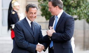 France's President Sarkozy greets Britain's Prime Minister Cameron at the Elyse Palce in Paris