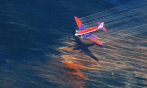 A US Coast Guard aircraft sprays oil dispersant over the Gulf of Mexico