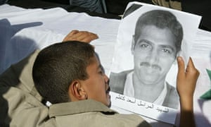 Assad Kadhim in a photograph held over his coffin by his grieving son