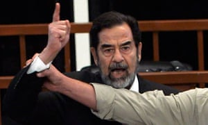 Saddam Hussein shouts in defiance as the death penalty is handed down against him