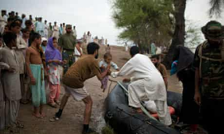 Baby girl rescued from Pakistan flooding 6/8/2010