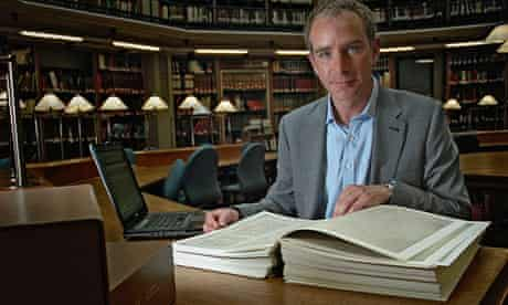 Stephen Baxter with a replica of the Domesday Book at Kings College London