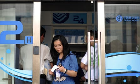 Woman at China Mobile self-service payment machine in Beijing