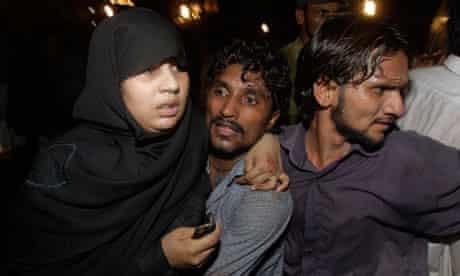 volunteers carry injured girl