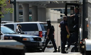 Police take up position in front of the Discovery Channel headquarters in Silver Spring