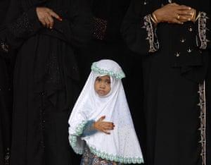 Eid begins: A Muslim girl attends Eid al-Fitr prayers at a school in Chennai, India