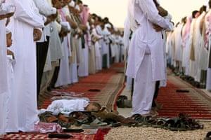 Eid begins: A child sleeps on the ground during Eid al-Fitr prayers in Diriyah