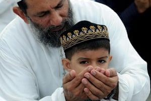 Eid begins: A Sri Lankan Muslim boy attends a special prayer to celebrate Eid al-Fitr