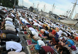 Eid begins: Hundreds of Indonesian Muslims perform the Eid al-Fitr prayer