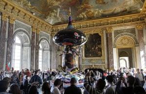 Murakami at Versailles: Visitors gather around a sculpture by Takashi Murakami entitled Tongari-Kun