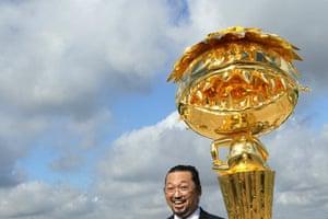 Murakami at Versailles: Japanese artist Takashi Murakami poses in front of Oval Buddha Gold