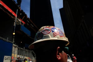 Ground Zero Mosque: A worker wears a helmet pasted with sticker against a proposed mosque