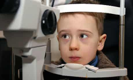 Young child having his eyes tested at opticians. Image shot 2009. Exact date unknown.