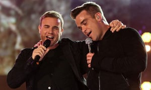 Gary Barlow and Robbie Williams on stage