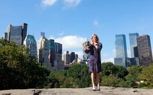 24 hours in sport: Kim Clijsters of Belgium poses with the women's U.S. Open tennis trophy