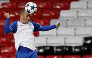 24 hours in sport: Rangers' Miller heads a ball during a training session