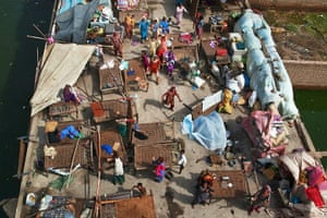 Six weeks later: Pakistan: Flood victims, trapped on a roof top, scramble for food rations