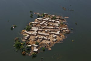 Six weeks later: Pakistan: Village surrounded by flood waters