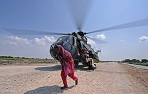 Six weeks later: Pakistan: A flood victim leaves a rescue helicopte