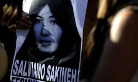 A demonstrator holds an image of Sakineh