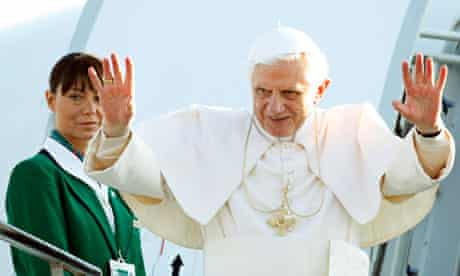 Pope Benedict XVI waves as he boards the aircraft taking him to the UK from Rome's Ciampino airport