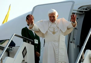 Pope arrives in Scotland: Pope Benedict XVI waves upon boarding a plane on his way to Scotland