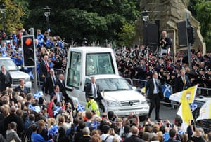 Pope day one: Pope Benedict XVI rides in the Popemobile down Edinburgh's Princes Street