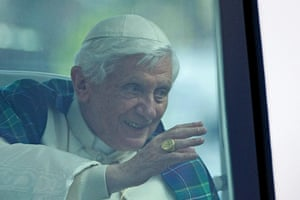 Pope day one: Pope Benedict XVI waves to the crowds