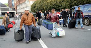 Roma Return : People belonging to the Roma community carry bags to Lesquin airport